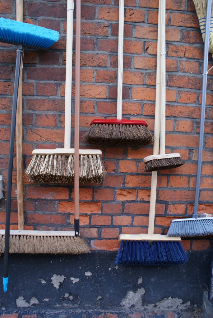 Shopping in Manningtree - Brooms hanging on wall